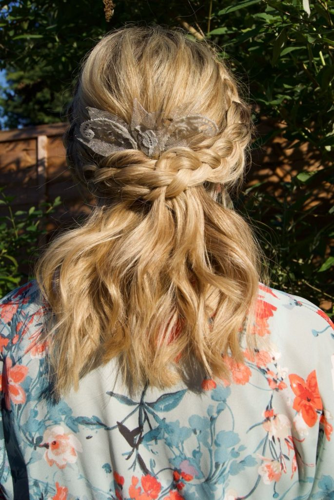 Waved medium length blonde hair. With wrapped Dutch braid. Crown volume. Luxury boho style. Silver leaf skeleton and vintage lace pins by Hayley Penny Creations