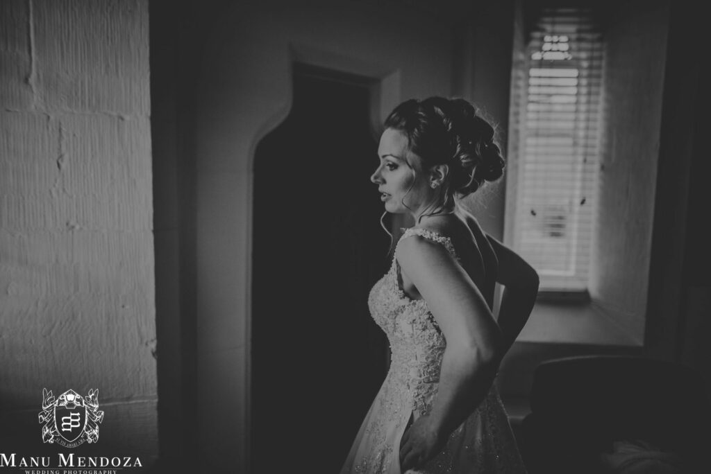 Beautiful Bride having a moment o herself before the ceremony. Wedding day at Peckforton castle