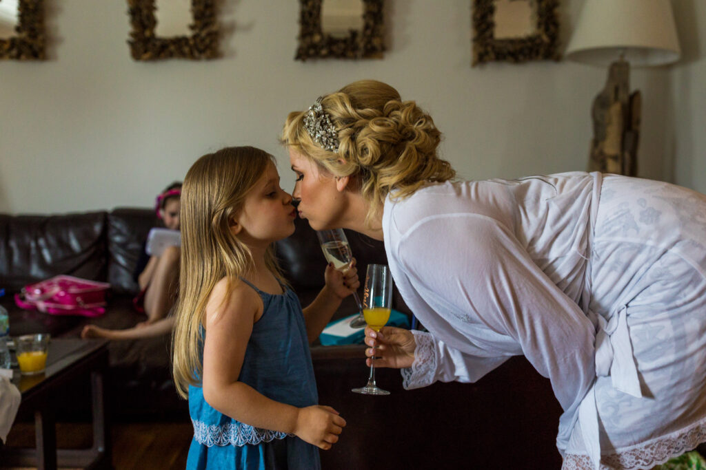 Mother and Daughter sahring a speical kiss when getting ready for the wedding day