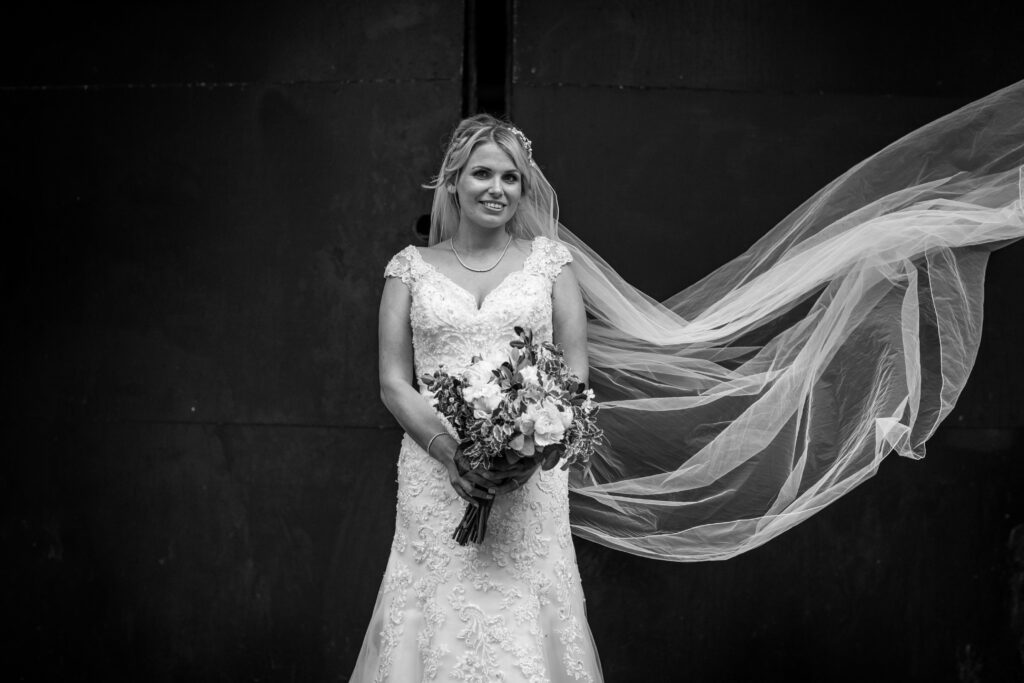 Brighton beach bride. Flying veil shot. Happy smiling bride