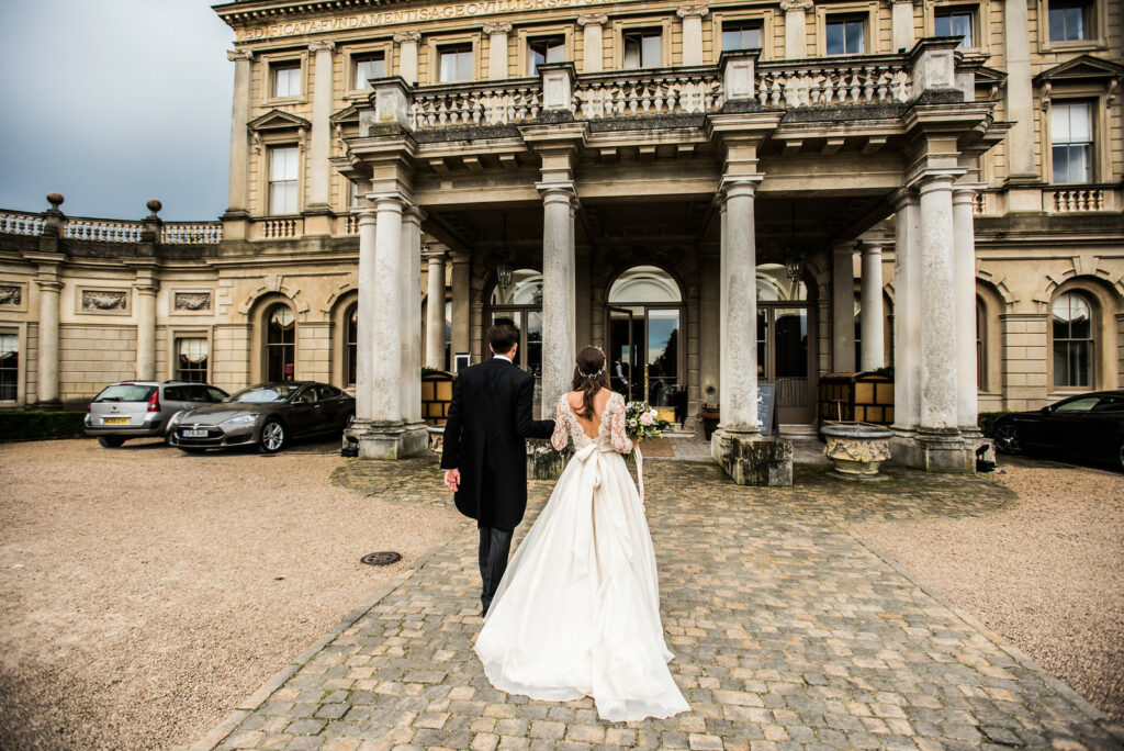 Newly Weds entering ClivedenHouse for their Wedding Breakfast