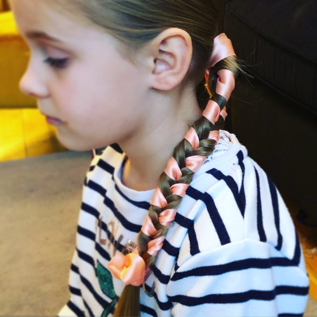 Clean, tidy and super cute. Fishtail plait with added ribbon.
