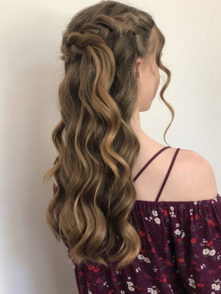 Beautfully soft waves and chunky braids for a modern prom queen