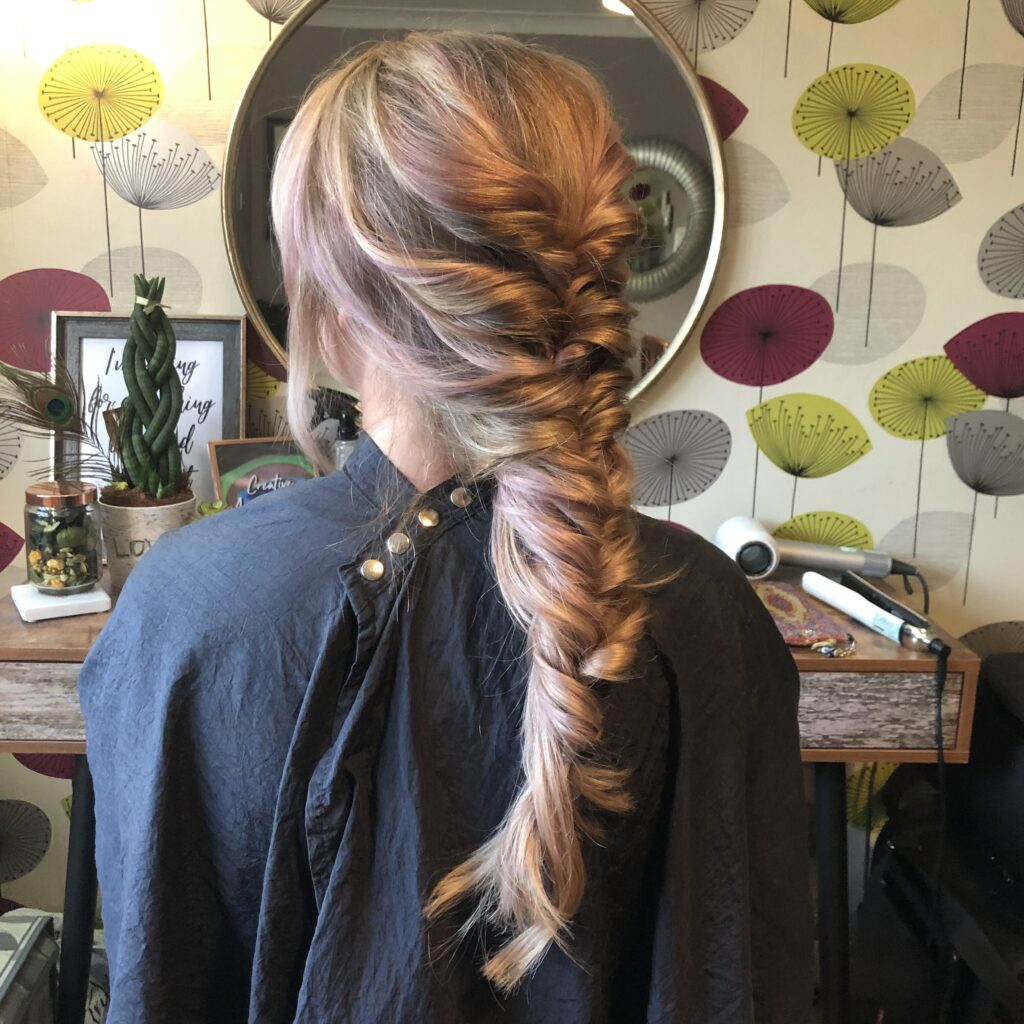 Tired and pulled twisted braid style. No pins necessary for this cool bridal style