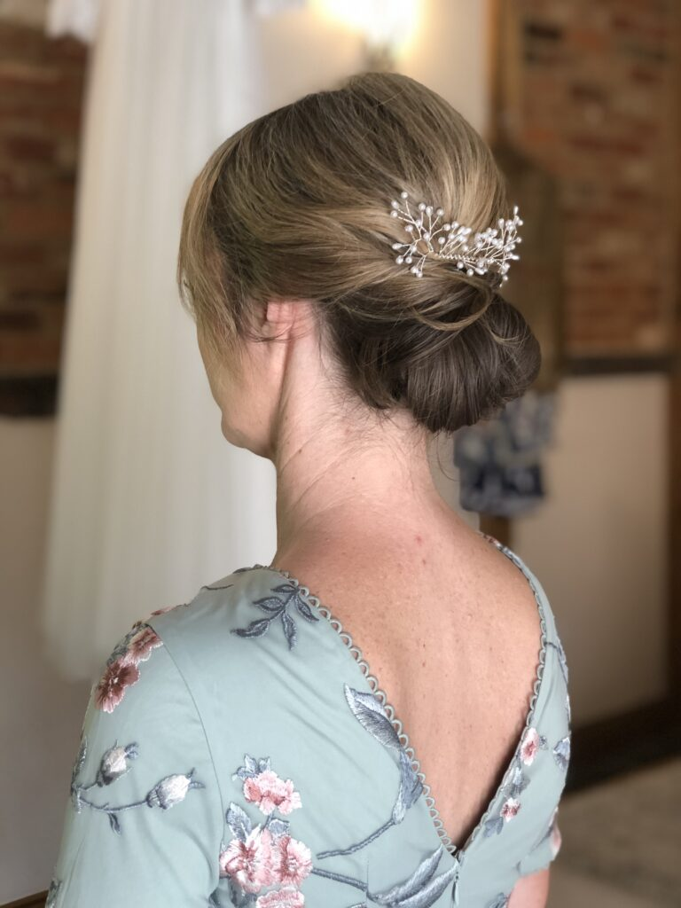 Elegant loose chignon for a beautiful mother of the bride.