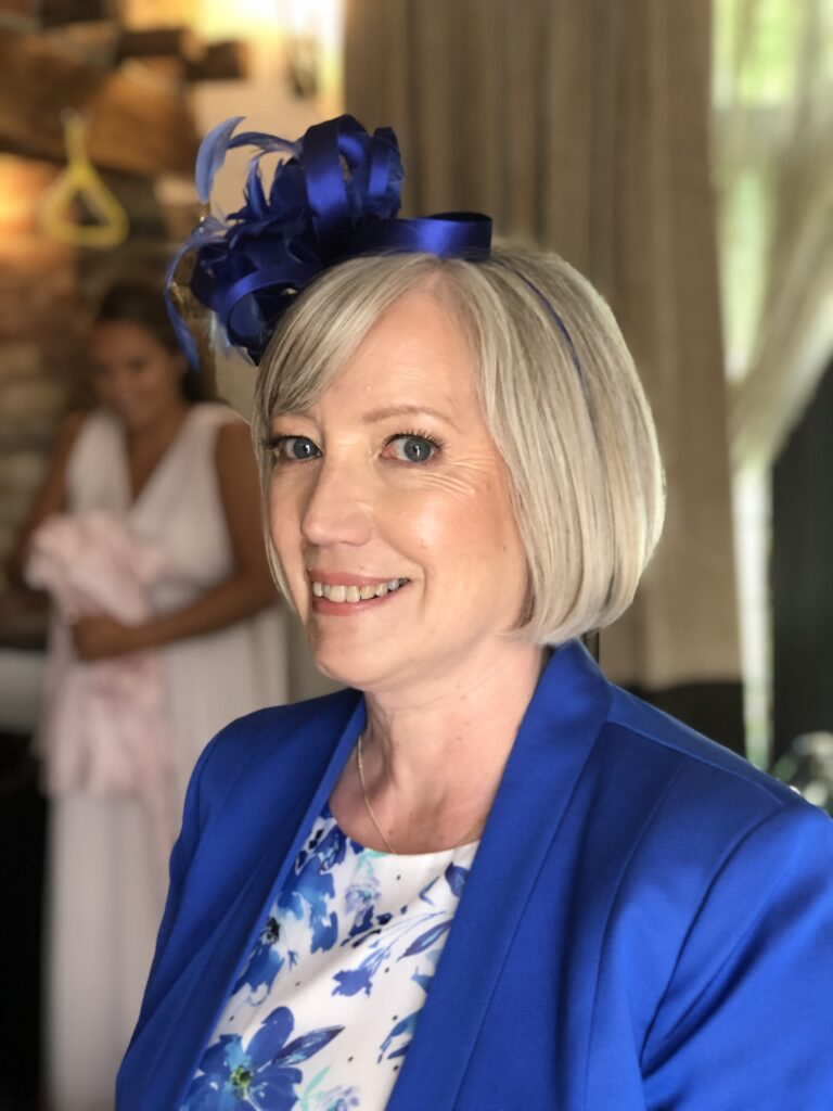 Blowdried flattering bob to compliment the beautiful blue fascinator