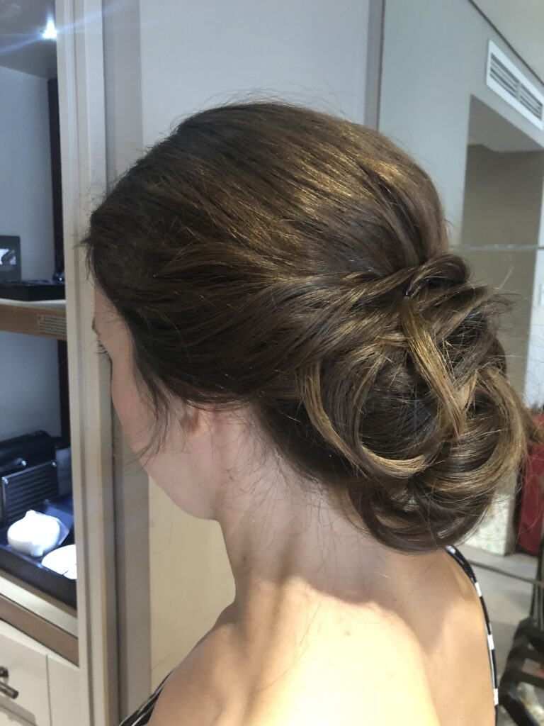 Low buns are still very on trend for 2020. Soft volume and twisted keep the cool texture.