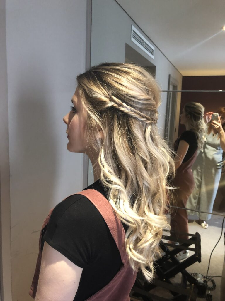 Fish tail braids, twists and waves add cool touches to a classic soft hair do