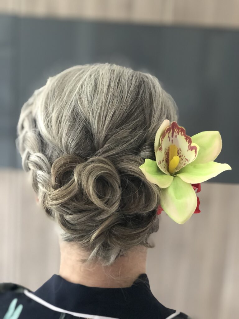 Vintage meets modern. A quirky updo for a windy day at the races. With Orchid flower hair clip