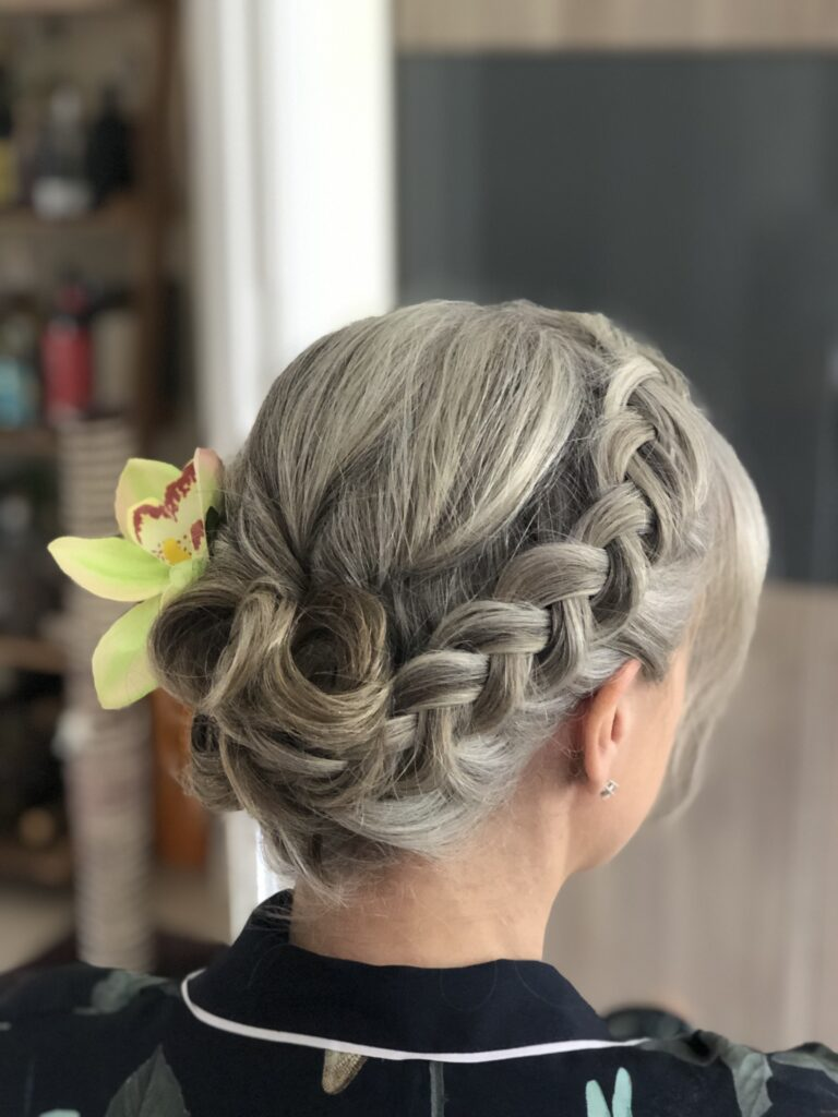 Vintage meets modern. A quirky updo for a windy day at the races.