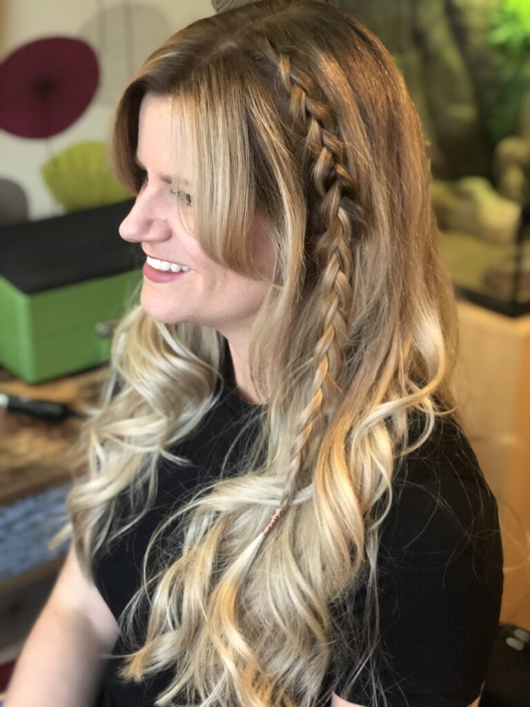 Long ash blonde hair waved using GHD Platinum Plus Styler with a single dutch braid to add extra texture. Finished with rose gold wire tie.