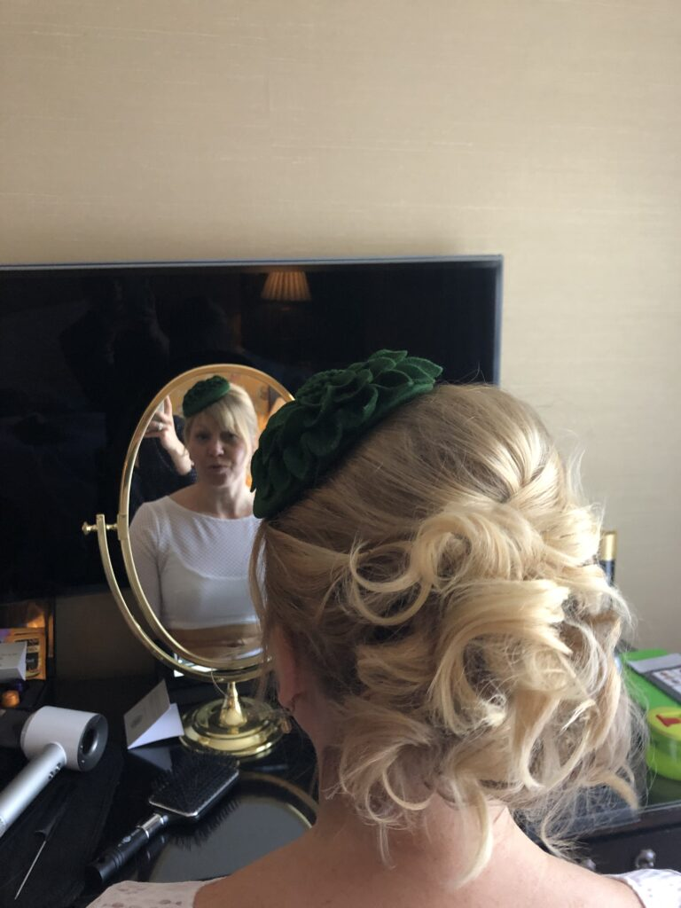 Short fine blonde bob twisted up to create a full textured hair up.  Christening guest hair.