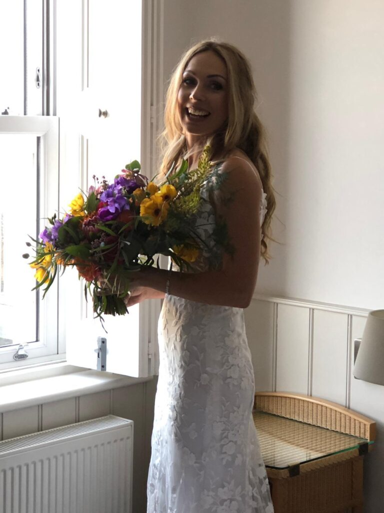 Beautiful Bride with bright bouquet